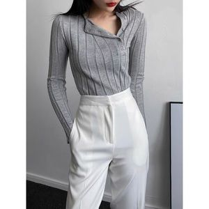 Like new grey knit top with asymmetrical buttons
